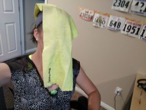 A cooling towel on Nicole Hillstead-Jones' head after a hot run