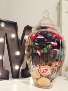running medals in a glass jar