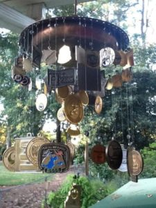 racing medals that have been turned into a windchime